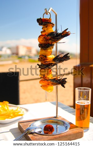 Mixgrilled seafood at seaside restaurant in portuguese - stock photo