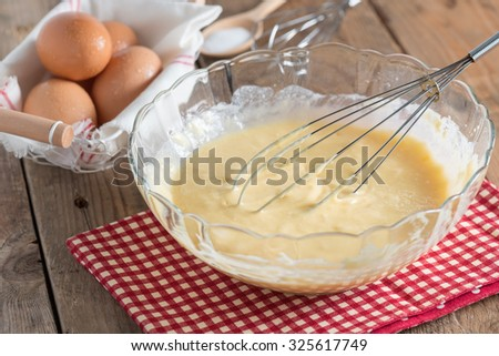 Mixing Batter for butter cake or pancake. - stock photo