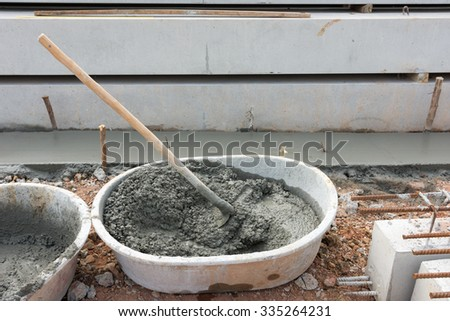 Mixing concrete by hand  - stock photo