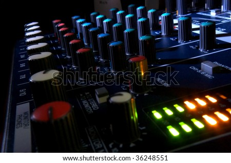 Mixing console at night. Musical background. - stock photo