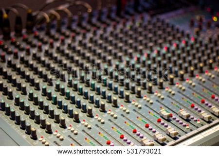 Mixing Console  of a big HiFi system  The audio equipment, control panel of digital studio mixer. Close-up