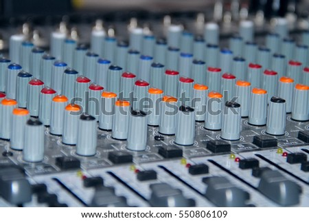 Mixing console shot in studio closeup