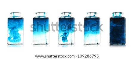 Mixing fluids in glass bottles - stock photo