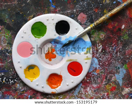 Mixing painting and paintbrushes - stock photo