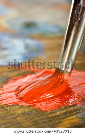 Mixing paints on palette - stock photo