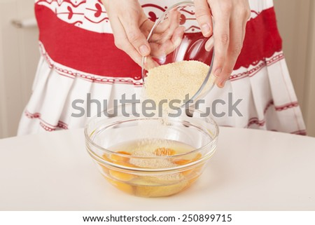 Mixing sugar with eggs - stock photo