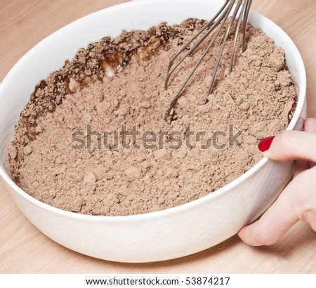 Mixing the brownie mixture. - stock photo