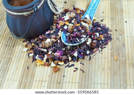 Mixture black tea ,  fruit tea with petals, dry berries and fruits and flover - stock photo
