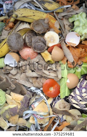 Mixture of compost heap materials comprising fruit and vegetable kitchen food waste with shredded newspaper. - stock photo