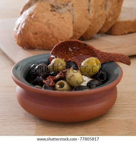mixture of green and black olives and feta cheese - stock photo