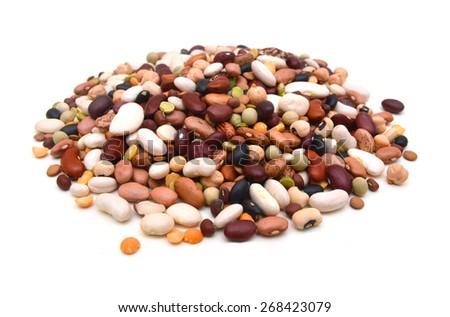 mixture of legumes on white background. - stock photo
