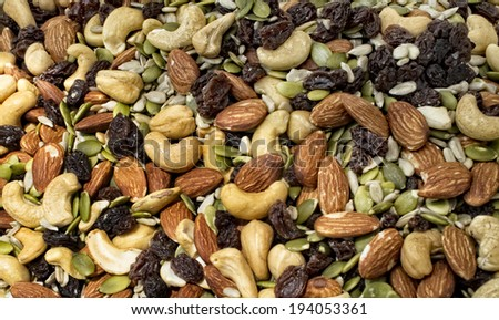 Mixture of nuts and dried fruit at local farm market. - stock photo
