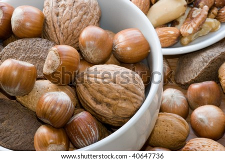 Mixture of nuts in a bowl lying on table