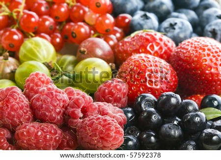 mixture of ripe berries collection  surface close up macro shot