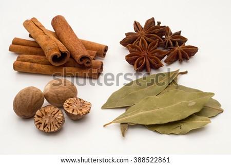 Mixture of spice - cinnamon, star anise, nutmeg, bay leaf - stock photo
