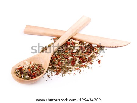 Mixture of spices in wooden spoon with wooden knife