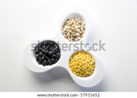 Mixture of three different type of colorful beans - stock photo
