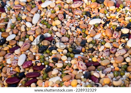 mixture of various raw legumes and spelt - stock photo