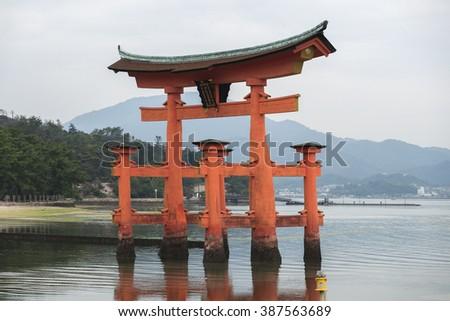 Miyajima, Hiroshima, Japan at the floating gate of Itsukushima Shrine. (gate sign reads Itsukushima Shrine) - stock photo