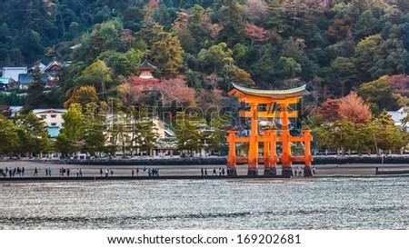 MIYAJIMA, JAPAN - NOVEMBER 15: O-Torii in Miyajima, Japan on November 15, 2013. Great floating gate (O-Torii) on Miyajima island near Itsukushima shinto shrine - stock photo