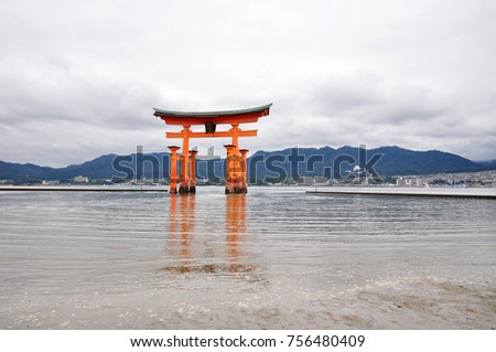 Miyajima, Japan - September 2017: Landscape of the great Torii at high tide and reflection over the water