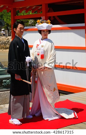MIYAJIMA - MAY 19 : Wedding in Itsukushima Shinto Shrine on 19 May 2016, Miyajima, Japan. According to Japanese custom people are wedding at Shinto shrines.