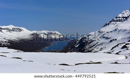 Mjoifjordur fjord with snow covered mountain in east Iceland