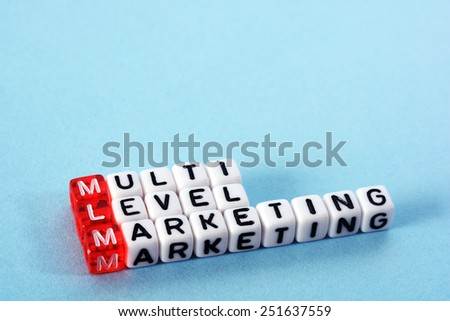 MLM Multi Level Marketing   written  on  cubes on blue  background - stock photo