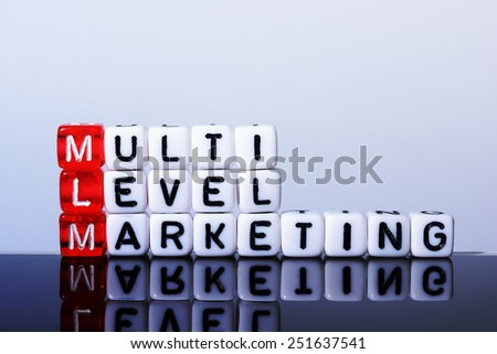 MLM Multi Level Marketing   written  on  cubes on white  background - stock photo