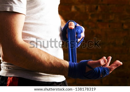 mma fighter is getting ready against brick wall - stock photo