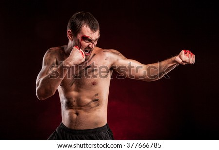MMA Fighter. Man Boxing On red Background. The Concept Of A Healthy Lifestyle. Blood on face. - stock photo