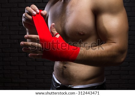 MMA Fighter Preparing Bandages For Training - stock photo