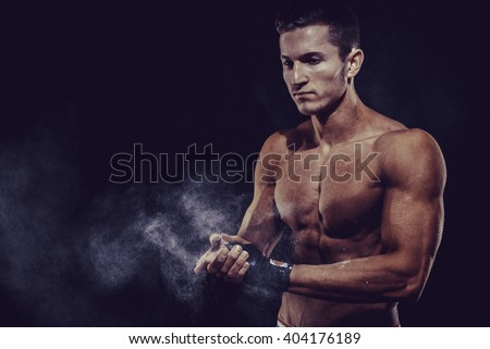 MMA Fighter Preparing Bandages For Training. Darck background - stock photo