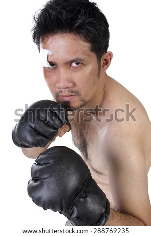 MMA fighter with fierce eye pose in orthodox boxing stance, isolated on white background - stock photo