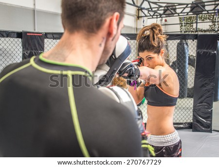 mma fighting training in the cage. concept about sport, fitness,mma,kickboxing,training, and people - stock photo