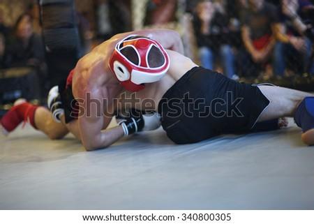 MMA grappling technique - stock photo