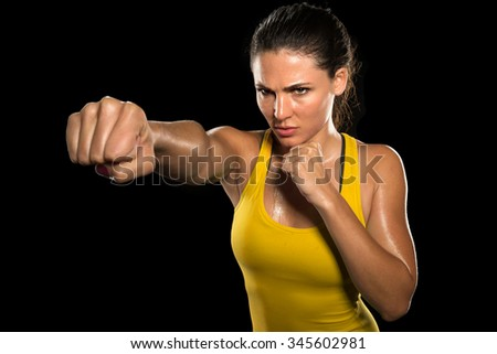 MMA woman fighter tough chick boxer punch pose pretty exercise training cross fit athlete - stock photo