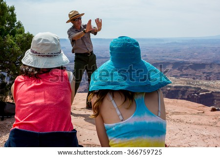 Moab, United States: July 1, 2015. NPS Park Ranger Talking about geological formations throughout time during a demonstration