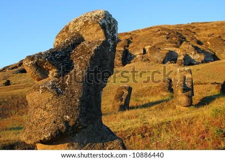 Moai Piro-Piro on Easter Island at sunset (Rano Raraku) - stock photo