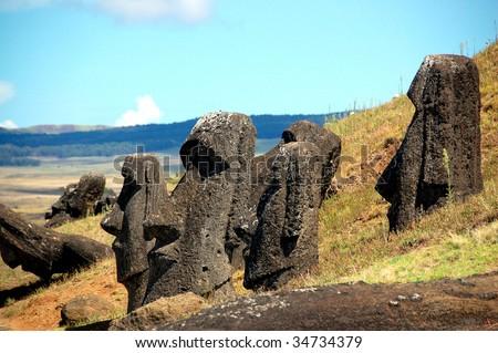 Moais on the slope of Rano Raraku volcano, Easter Island - stock photo