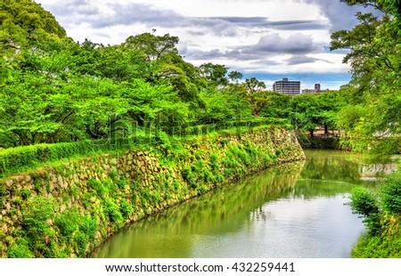 Moat at Himeji Castle in the Kansai region of Japan - stock photo