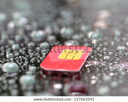 Mobil sim card on wated drop background - stock photo