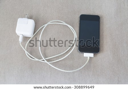 mobile and charger  - stock photo