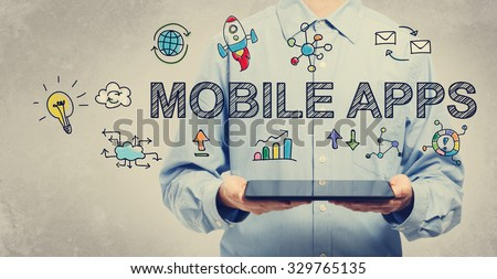 Mobile Apps concept with young man holding a tablet computer