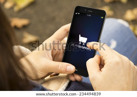 mobile business concept: Female hands using smart phone for online shopping - stock photo