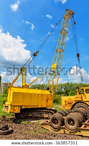 Mobile caterpillar crane on a background of blue sky - stock photo
