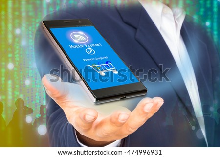 Mobile commerce and payment concept. .Business Man showing  smart phone with mobile payment application against abstract digital code background.