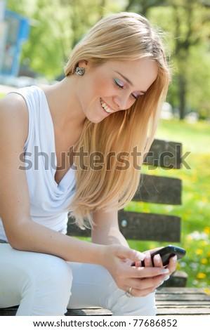 Mobile communication - happy teenager - stock photo