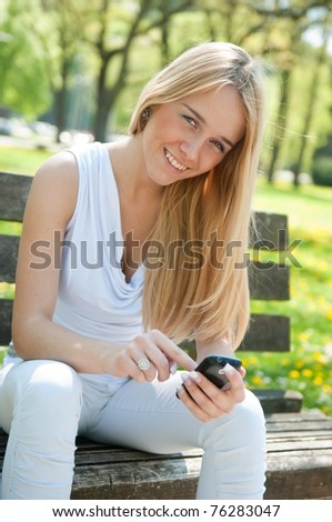Mobile communication - smiling teenager - stock photo