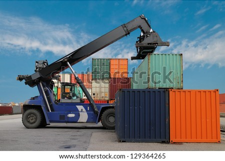 Mobile crane and cargo container on a transport site - stock photo